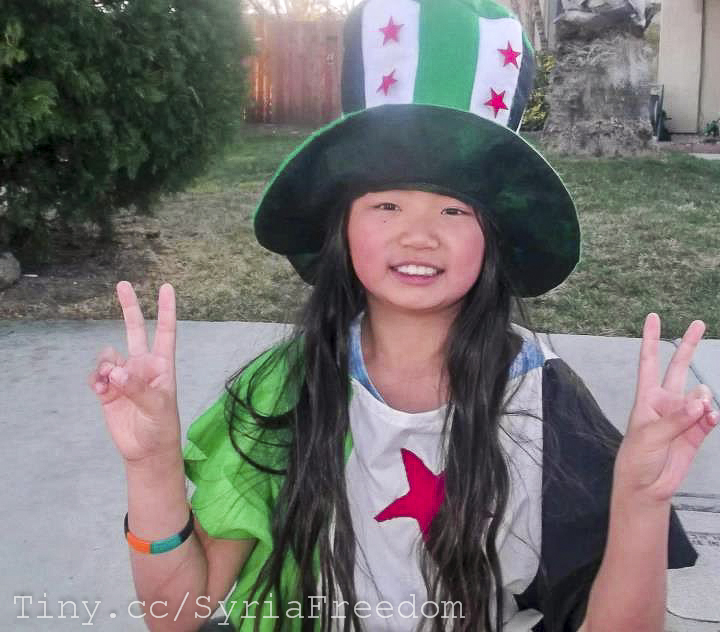 Ein seltenes Bild - eine Chinesin in syrischen Revolutionsfarben. ©FreedomHouse2 via flickr